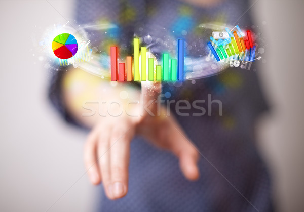 Stock photo: Young businesswoman touching colorful modern graph system concep