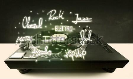 Turntable with vinyl and music genres writen  Stock photo © ra2studio