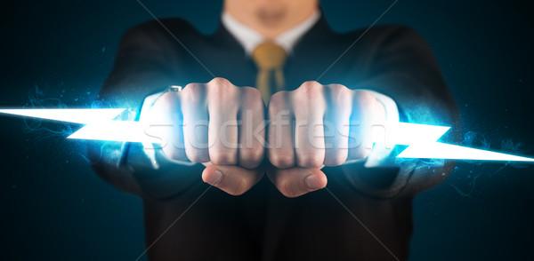 Stock fotó: üzletember · tart · izzó · villám · kezek · tűz
