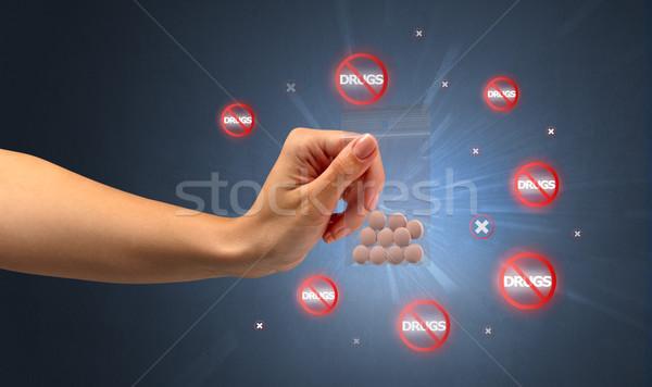 Anti-drug concept and hand giving pills Stock photo © ra2studio