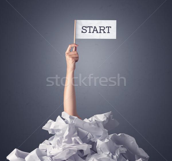 Female hand holding start sign Stock photo © ra2studio