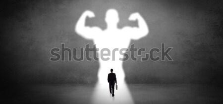 Biznesmen stałego silne bohater wizji Zdjęcia stock © ra2studio
