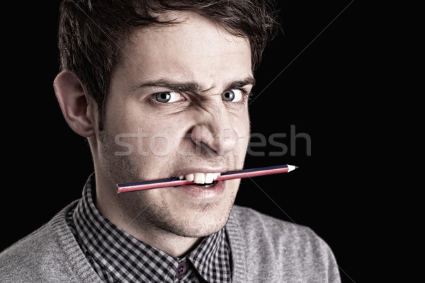 portrait of a young man with pencil  Stock photo © ra2studio