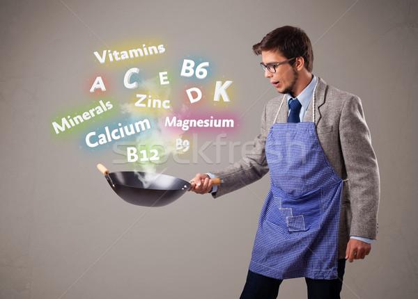 Homem cozinhar vitaminas minerais homem bonito comida Foto stock © ra2studio