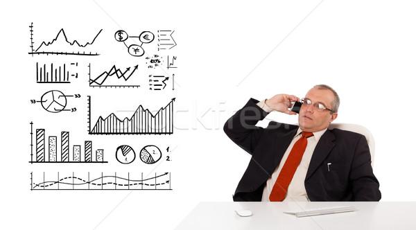 üzletember ül asztal diagramok készít telefonbeszélgetés Stock fotó © ra2studio