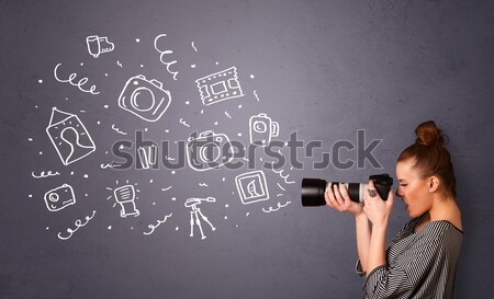 Young photographer shooting photography icons Stock photo © ra2studio