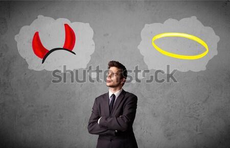 Biznesmen dobre złe młodych tle Zdjęcia stock © ra2studio
