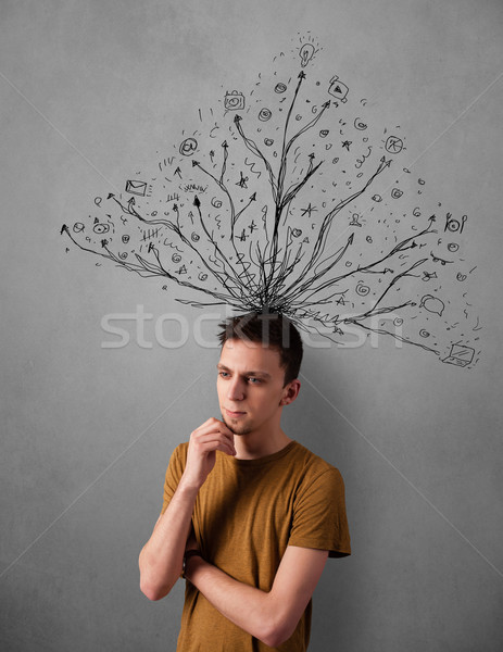 Young man with tangled lines coming out of his head Stock photo © ra2studio