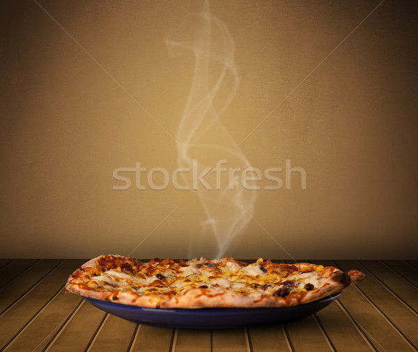 Fresh delicious home cooked pizza with steam Stock photo © ra2studio