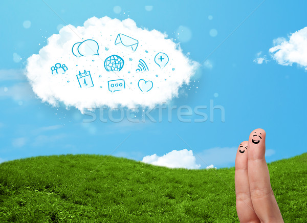 Happy cheerful smiley fingers looking at cloud with blue social icons and smybols Stock photo © ra2studio