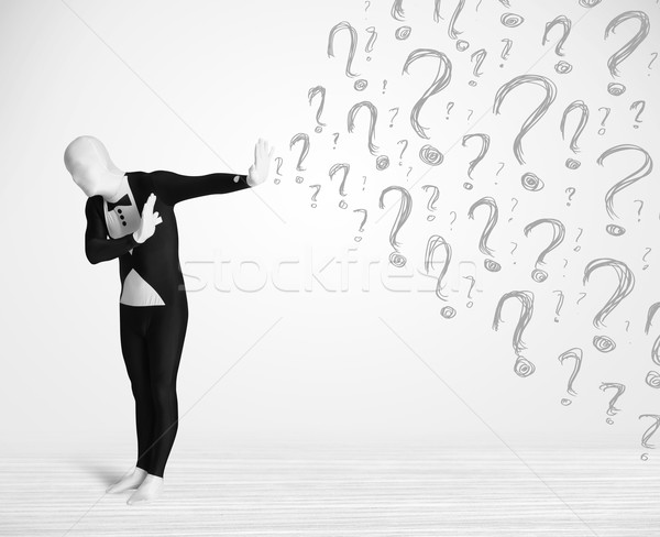 3d human character is body suit morphsuit looking at hand drawn question marks Stock photo © ra2studio