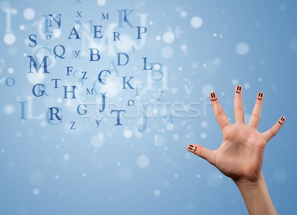 счастливым пальцы глядя смесь bokeh Сток-фото © ra2studio