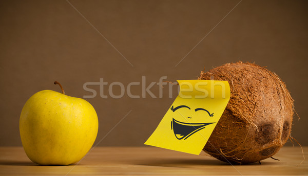 Coconut with post-it note laughing on apple Stock photo © ra2studio