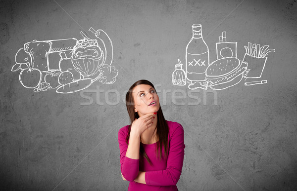 Frau stehen gesunden ungesund Lebensmittel ziemlich Stock foto © ra2studio