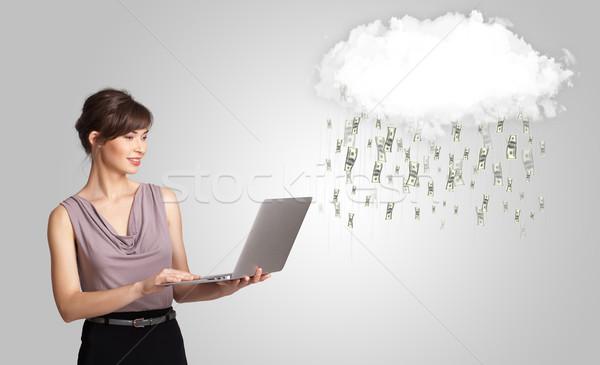 Woman with cloud and money rain concept Stock photo © ra2studio