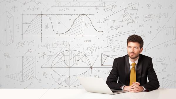 Empresário negócio homem de negócios sessão branco tabela Foto stock © ra2studio