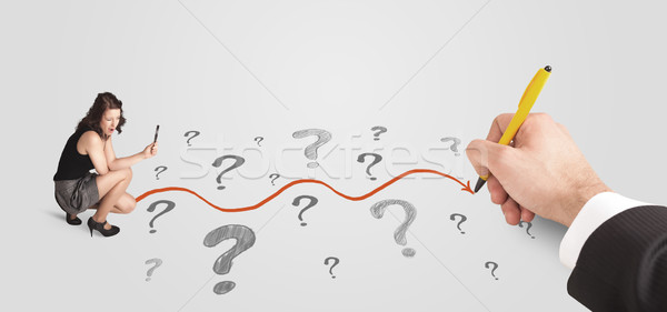 Business woman looking at question marks and solution path Stock photo © ra2studio