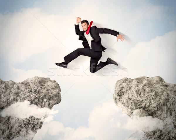 счастливым деловой человек прыжки утес бизнеса человека Сток-фото © ra2studio