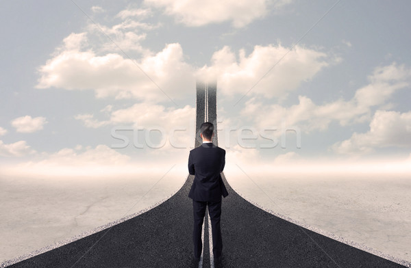 Businessman looking at 3d road that goes up in the sky Stock photo © ra2studio