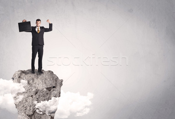Best salesman on cliff in clear space Stock photo © ra2studio