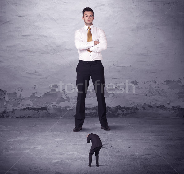 Angry big manager looking at small business man Stock photo © ra2studio
