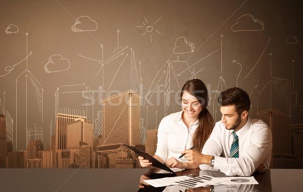 Business Coppia edifici seduta nero tavola Foto d'archivio © ra2studio