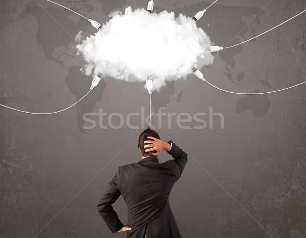 Fiatalember néz felhő átutalás világ szolgáltatás Stock fotó © ra2studio