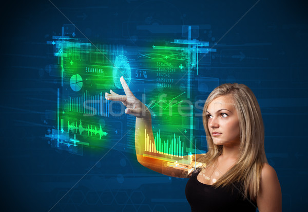 Young businesswoman pressing modern technology panel with finger Stock photo © ra2studio