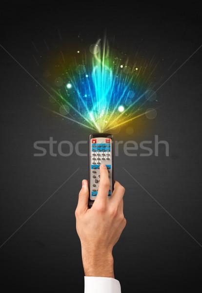 Mão controle remoto explosivo sinalizar brilhante Foto stock © ra2studio