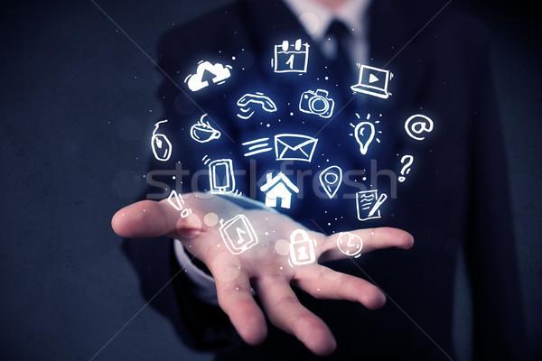 Businessman holding blue applications Stock photo © ra2studio