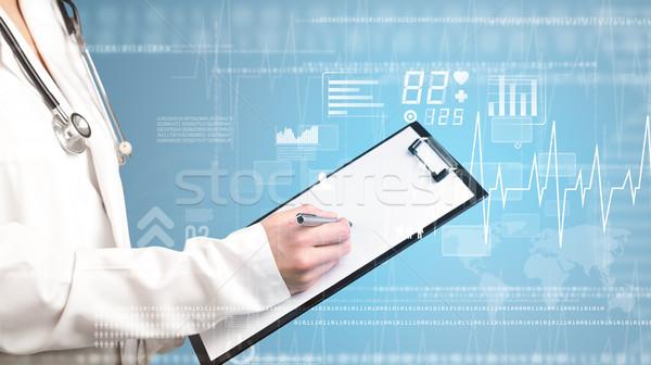 Kobiet lekarza notatnika niebieski serca Zdjęcia stock © ra2studio