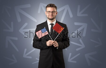 Handsome businessman with magic ball and dark empty background Stock photo © ra2studio
