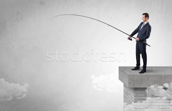 Işadamı balık tutma hiçbir şey üst bulut ücretsiz Stok fotoğraf © ra2studio