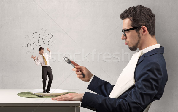 Huge businessman guting small businessman Stock photo © ra2studio