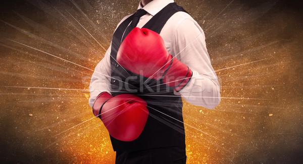 Forceful businessman boxing Stock photo © ra2studio