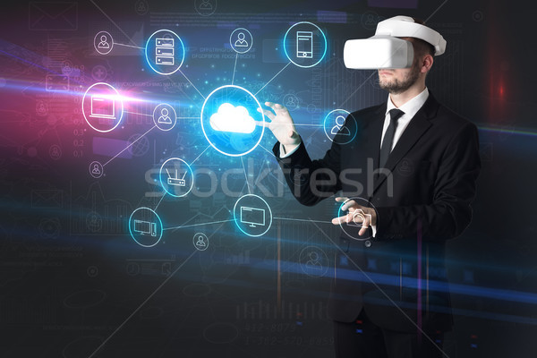 Man in vr glasses with social media concept icons Stock photo © ra2studio