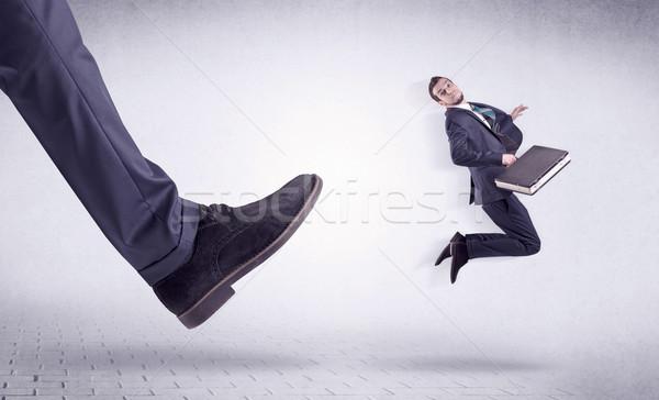 молодые работник из большой ногу небольшой Сток-фото © ra2studio