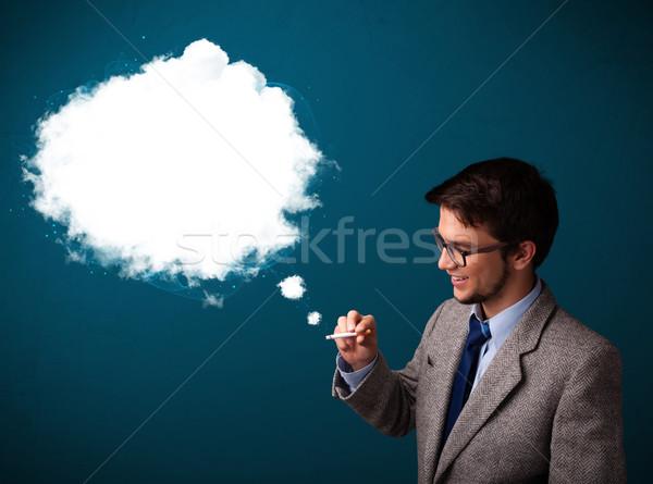 Jeune homme fumer malsain cigarette fumée Photo stock © ra2studio