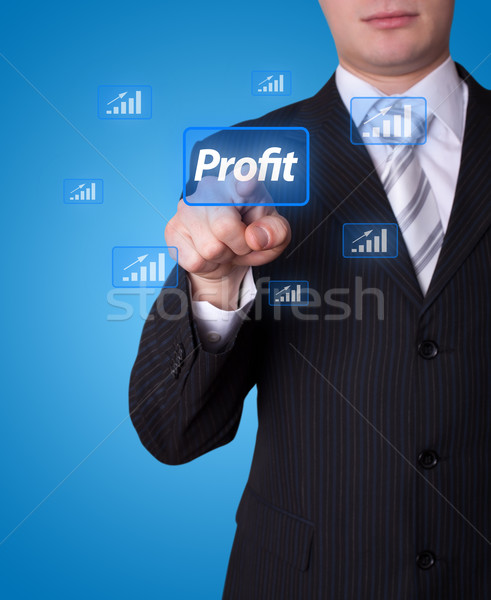 Man pressing profit button Stock photo © ra2studio