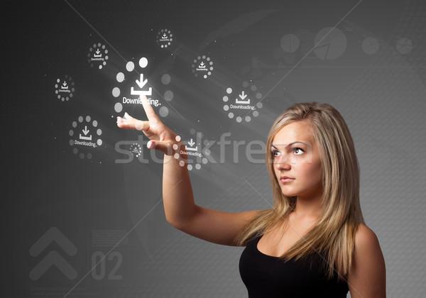 Businesswoman pressing simple type of start buttons Stock photo © ra2studio