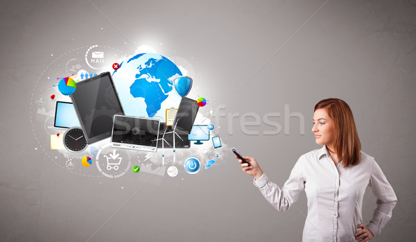Stock photo: young woman standing and browsing on her phone