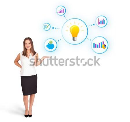 Jonge vrouw presenteren gloeilamp kleurrijk diagrammen geïsoleerd Stockfoto © ra2studio