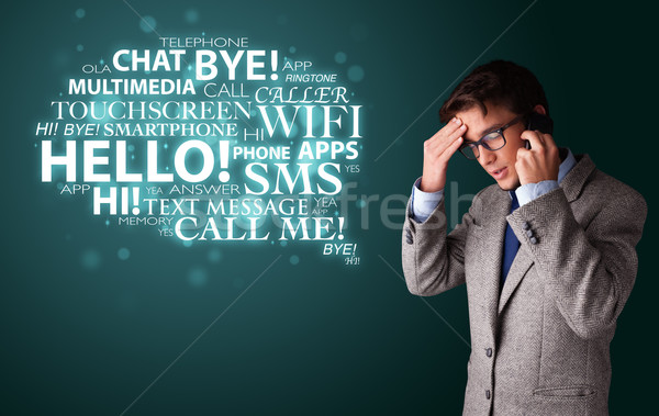 Young man making phone call with word cloud Stock photo © ra2studio