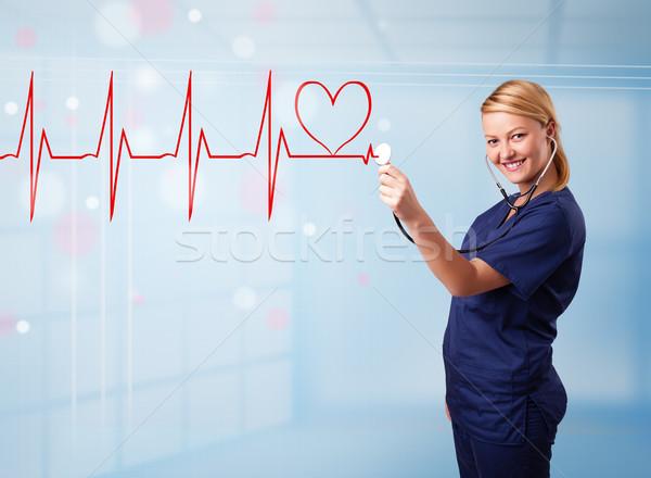 Młodych pielęgniarki słuchania streszczenie puls czerwony Zdjęcia stock © ra2studio