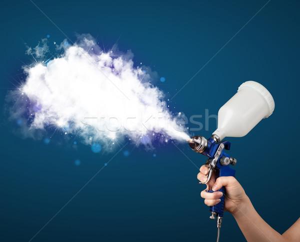 Painter with airbrush gun and white magical smoke  Stock photo © ra2studio