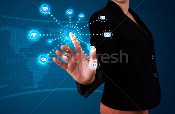 Woman pressing virtual messaging type of icons Stock photo © ra2studio
