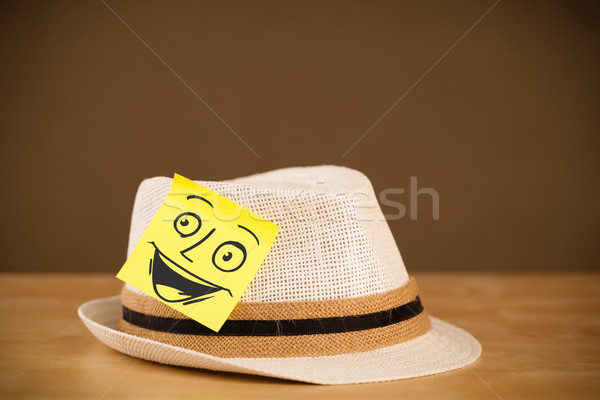 Post-it note with smiley face sticked on a hat Stock photo © ra2studio