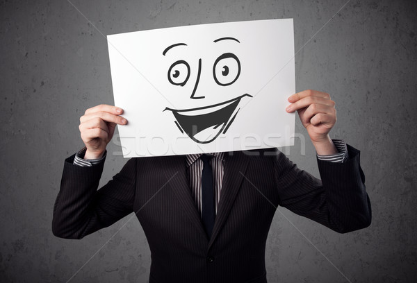 üzletember tart karton mosolygós arc elöl fiatal Stock fotó © ra2studio