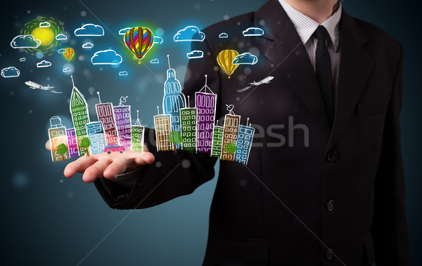 Young businessman presenting colorful hand drawn metropolitan ci Stock photo © ra2studio
