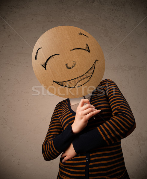 Young woman holding a smiley face board Stock photo © ra2studio